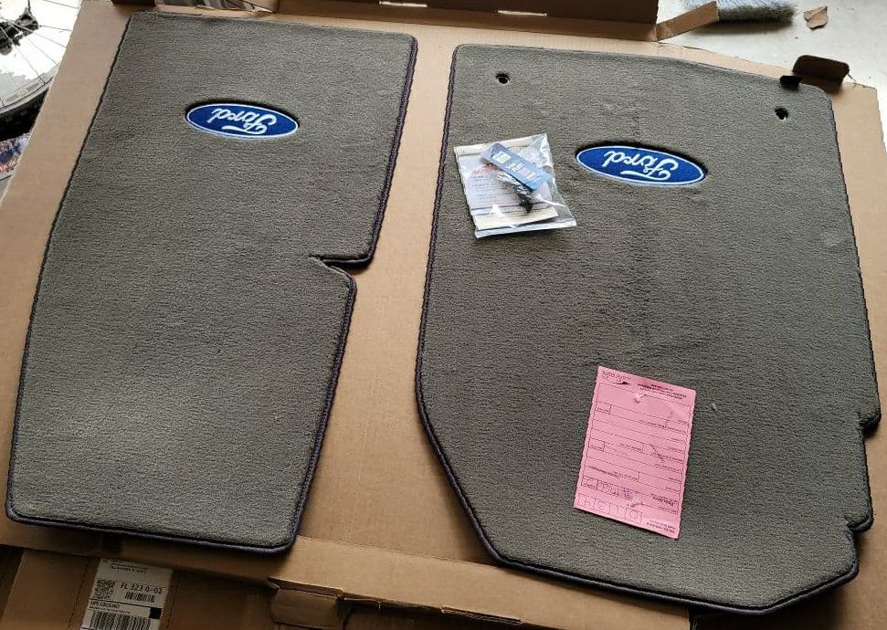 Lloyd Mats ® - Velourtex Grey Front Floor Mats For Ford F-150 Reg Cab 4wd on Floor with Blue and Silver Ford Oval Logo